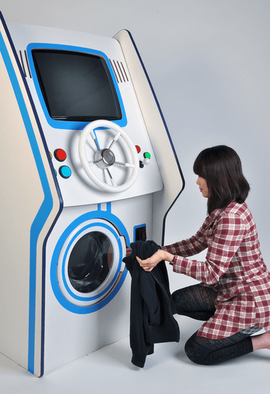Putting Clothes in Coin Slot Game Washer